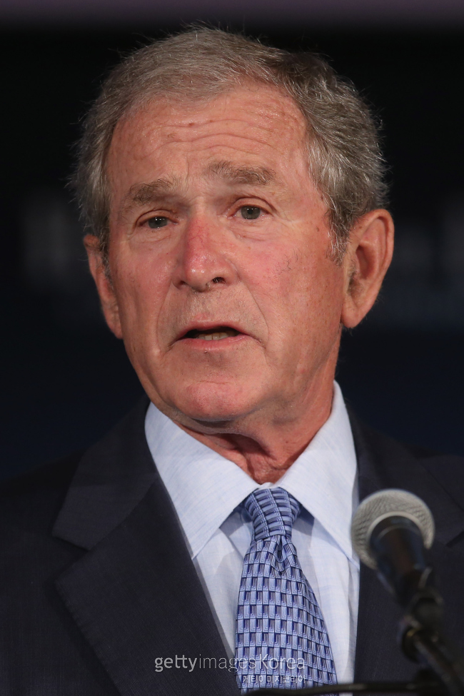 """WASHINGTON, DC - JUNE 24: Former U.S. President George W. Bush addresses a summit on """"creating employment opportunities for post-9/11 veterans and military families"""" at the U.S. Chamber of Commerce June 24, 2015 in Washington, DC. Sponsored by the chamber's Hiring Our Heroes program and the George W. Bush Institute's Military Service Initiative, the event also served as a launch for the Veteran Employment Transition (VET) Roadmap, a military transition guide. (Photo by Chip Somodevilla/Getty Images)"""