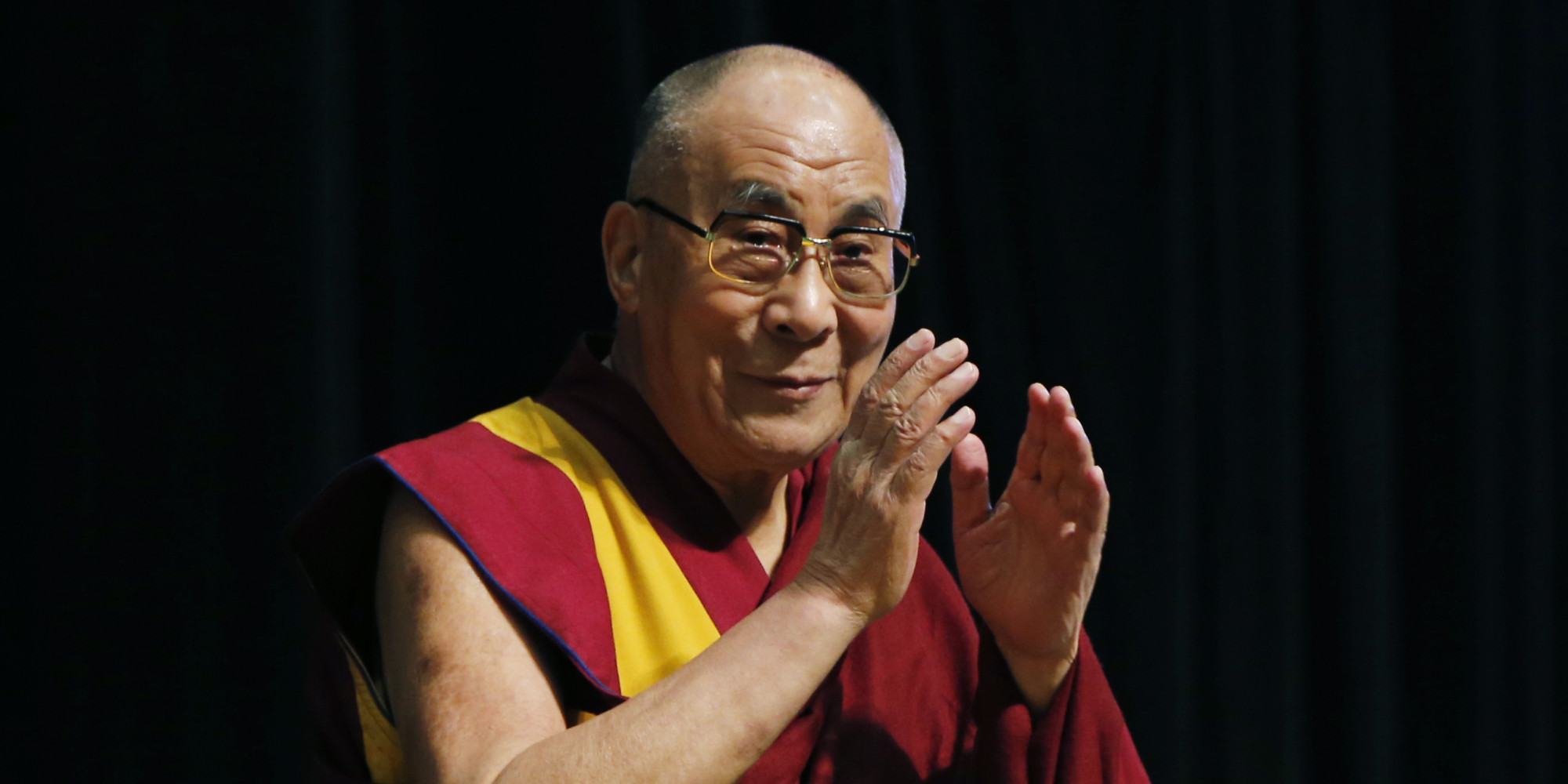 Tibetan spiritual leader the Dalai Lama greets an audience before his religious speech in Tokyo, Monday, Nov. 25, 2013. The Dalai Lama is in Japan for a 12-day visit to deliver speeches.(AP Photo/Koji Sasahara)